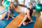 couple stretching gym