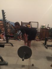 stiff-legged deadlifts in the garage gym
